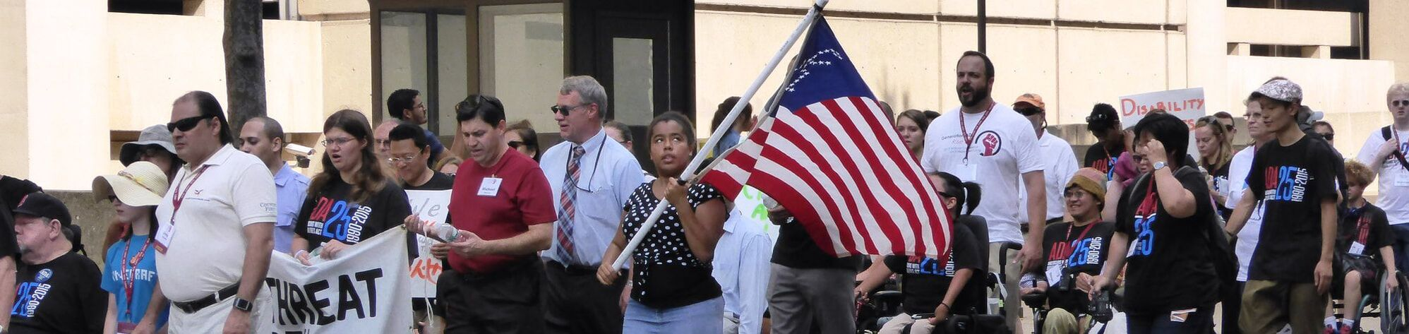 Gril with flag in Washington DC during ADA celebration